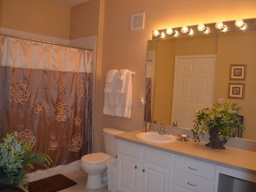 Large 2nd bath w/ tub/shower. Fluffy luxury bath linens, seated vanity, hairdyer
