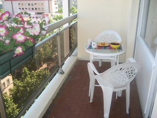 Lyon studio photo - Breakfast on balcony overlooking leafy street