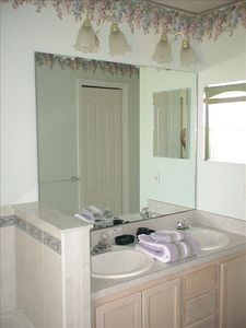 Twin vanities in master suite