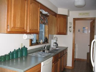 Lake Winnisquam condo photo - Fully Stocked Kitchen and Laundry Room