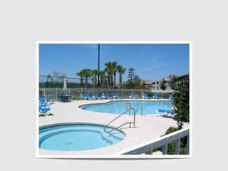 Celebration condo photo - Pool, Jacuzzi, Behind Club House with Condos in background