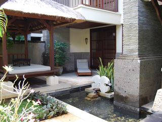 Nusa Dua apartment photo - Pond and sun lounger
