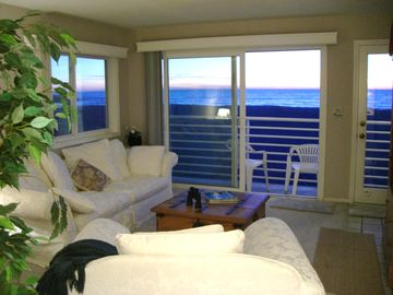 Living room and balcony 100% Ocean and Beach views. The Beach is Your Front Yard