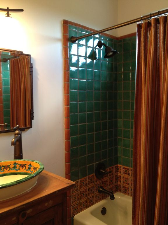 Guest bathroom w/ ceramic tile sink, shower and bathtub