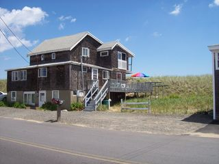 Plum Island house photo - View of house from street - Beach is right on the other side of dune with grass