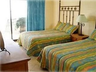 San Jose del Cabo condo photo - Large guest bedroom with two full size beds