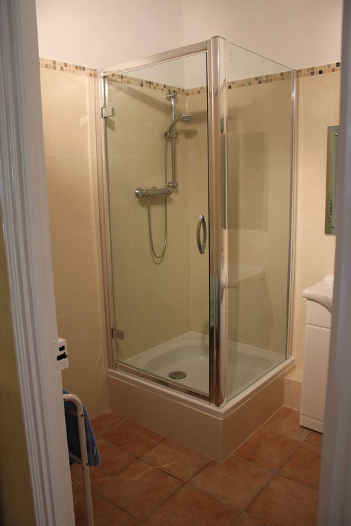 Large shower cubicle in shower room