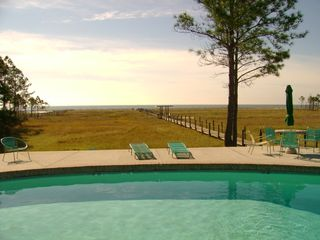 Dauphin Island condo photo - Swimming pool with lounge chairs & view of beach.