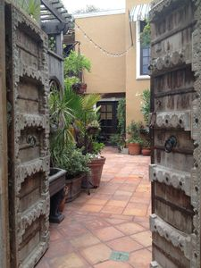 Pass thru 200 year old Indian Gates to the Spanish tiled courtyard w 2 fountains