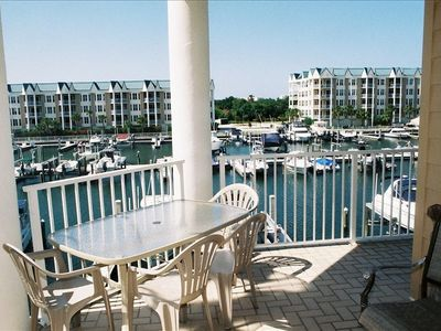 Wrap around patio with views of Intra coastal, boat slips, and wetlanfd.
