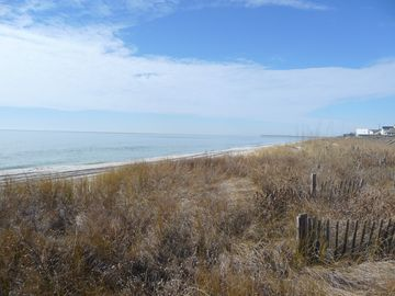 Ocean and beach looking Southeast to fishing pier from dune pathway