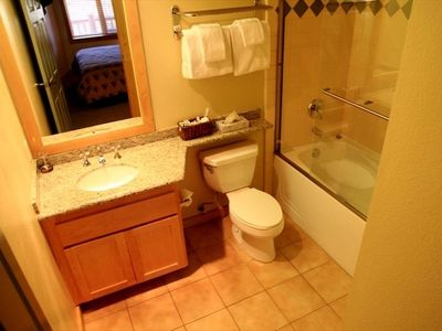 Attached bathroom with bath towels provided