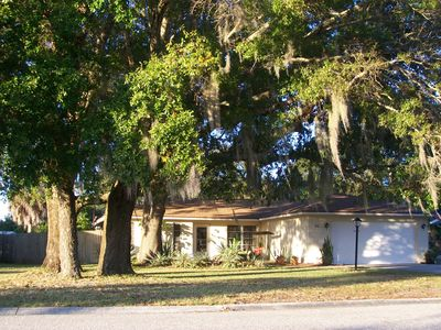 Vacation home on quiet, but friendly street with HUGE canopy trees.