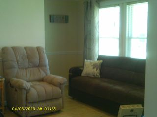 Beach Haven Garden house photo - Other view of family rm. TV cabinet contains games, videos for child. & adults