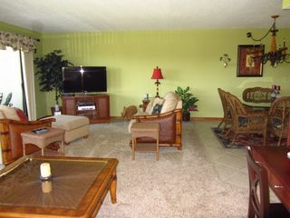 Spacious living room and large flat screen and surround sound - Cocoa Beach condo vacation rental photo