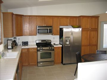 Spacious kicthen with room for friends to hang out with the cook. New appliances
