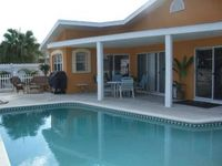 Decorators Delight - Pool Home on Canal - walk to the beach