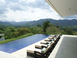 Nicoya house photo - Infinity Pool ranges in depth from 3 feet to 9 feet, with a sunbathing ledge.