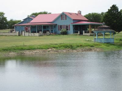 Austin farmhouse rental - Lake House with Gazebo and Party Barn in Background.