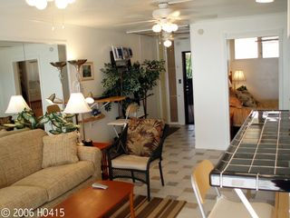 Lahaina condo photo - Drop-Leaf Dining Tables Are Attached Under Bar.