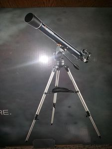 Telescope located at the house for star gazing or viewing the landscape.