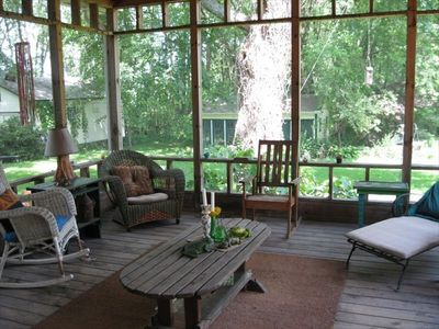 Spacious and relaxing screened in porch with views of pond and gardens.