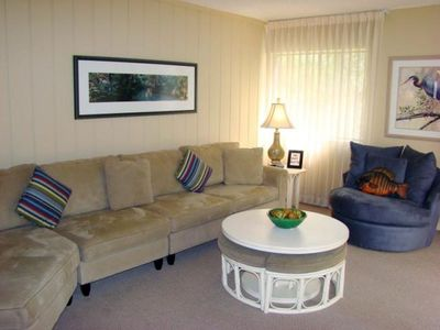 Living Room with pull-out double bed. Overlooks beautiful live oaks and pond.
