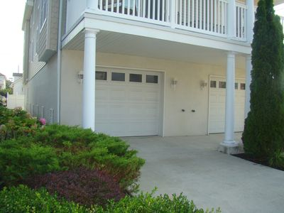The left side garage is included and will fit 2 cars plus one in driveway!