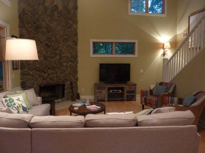 "Family room with 55"" LED TV, Blu-Ray player and bluetooth sound system."