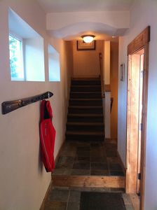 Entry way with ski coat rack.