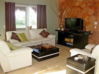 Playa del Carmen condo photo - Comfy new furniture for watching satellite TV or movies on the DVD player.