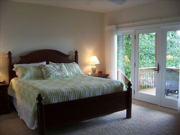 Master bedroom (King) with attatched porch. Fireplace on this porch. Jacuzzi tub