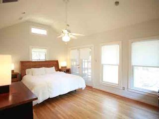 Austin house photo - Master bedroom with vaulted ceilings, french doors leading to back porch