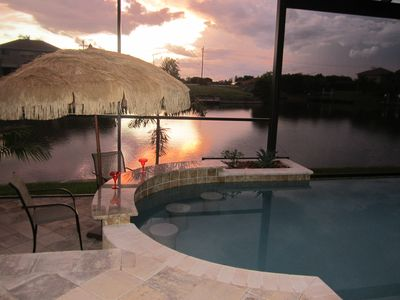Relax and watch the sunsets from the Swim Up Pool Bar!