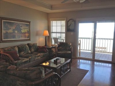Open concept living area with sliding glass doors has incredible bay/ocean view!