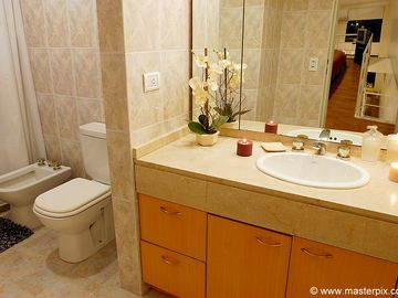 Bathroom has plenty of storage space and toilet with bidet and shower & jacuzzi