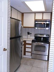 Garden City Beach condo photo - Fully equipped kitchen with dishwasher, microwave, and small appliances