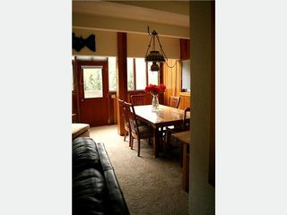 Taos Ski Valley condo photo - Dining table just off the living area with a balcony view