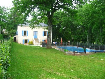 family home with swimming pool and park