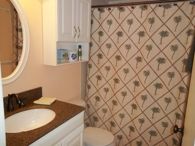 Cocoa Beach condo rental - Master bathroom with tile shower.