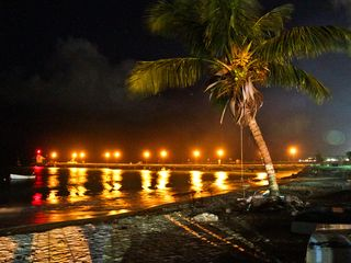 Atlantic Shores apartment photo - The jetty at Oistins awash in golden splendour.