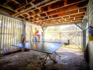 Tybee Island cottage photo - Gameroom with ping pong and beach cart.