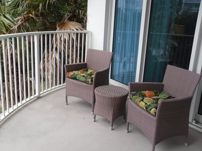 Balcony with view of pool below. Access to balcony from master bedroom and den