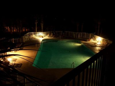 The pool, as evening engulf's your balcony.