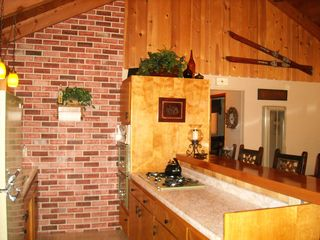 Big Bear Lake cabin photo - Kitchen accent - Faux brick wall. Also Vintage Ski's accent wall above