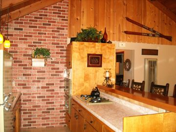 Kitchen accent - Faux brick wall. Also Vintage Ski's accent wall above