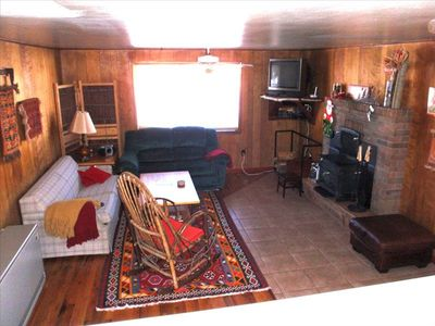 Living Room with cable TV, 200  DVDs, ceiling fan and wood burning fireplace.