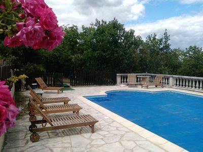 Sarrazac villa rental - fenced pool with deck chairs
