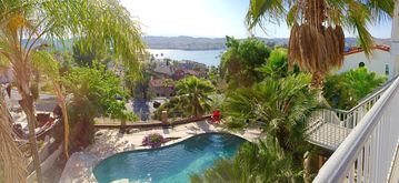 Canyon Lake house rental - panoramic shot of pool, jacuzzi, 360 degree mountains, and view near sunset