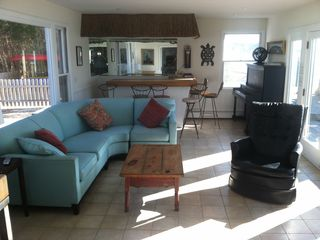 "Hampton Bays house photo - Sunroom, Kayaks outside the window, Tiki wet bar, 55"" HD TV (not in the picture)"